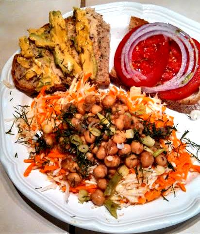 Lime chipotle chickpeas on salad with avocado tomato onion sandwich